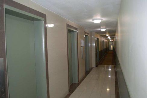 135 - Carpeted Hallway with elevator landing samll